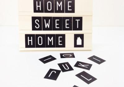 tekstbord hout met letters en symbolen
